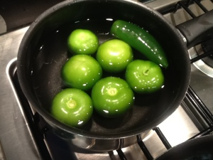 6 Tomatilla & 1 Jalapeno into pot of water.  Cook for 20 minutes of until Tomatillas have lightened in color.