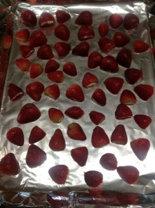 Place strawberries on roasting pan lined with foil and cook at 425 degrees for 15-20 mins.  DO NOT BURN