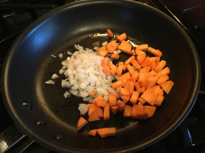 I take 2 TBS of the bacon grease (always SAVE the bacon grease!!) and put into a saute pan. I then add the sweet potatoes and onion and cook for 5-6 mins until softened.