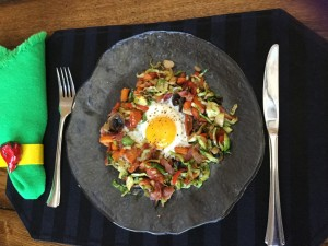 Sweet Potatoes with Brussel Sprouts, other veggies and BACON make up this Paleo Breakfast!